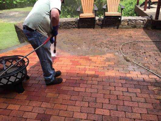 Power wash brick patio and stamped concrete in Woodbury Ct