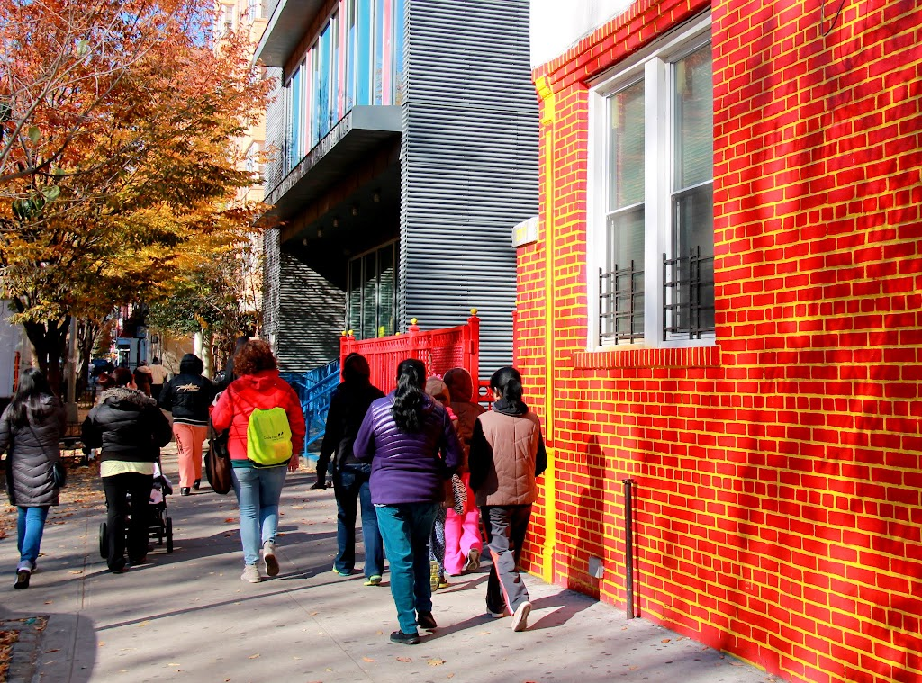Fall foliage matches the painted brick