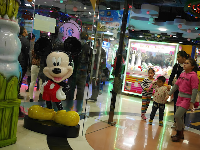 large Mickey Mouse statue outside an arcade in Xiamen