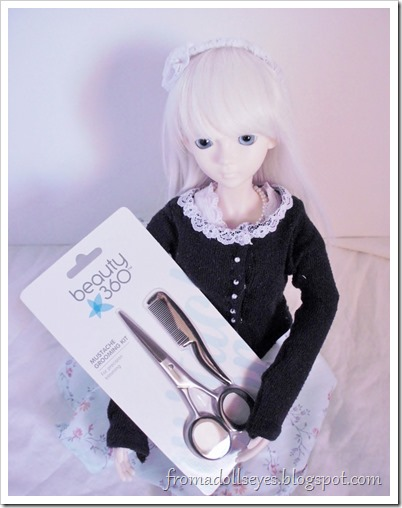 Using a mustach grooming kit to cut and style doll hair.