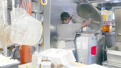 In the Kitchen with Chef Owner Troy MacLarty of Bollywood Theater - separating the cheese and whey for the paneer