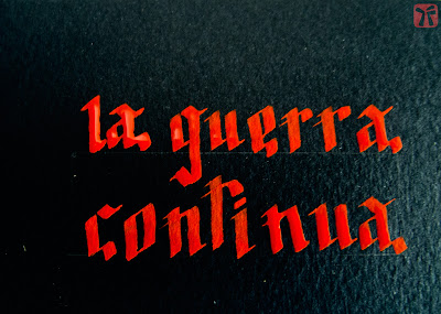 Detall títol manuscrit La guerra continua