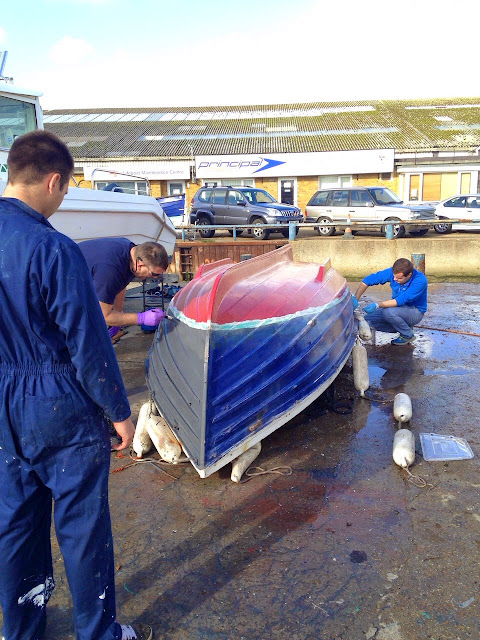 The boarding boat has its bottom repainted! 2 November 2014.  Photo credit: Alex Evans