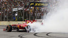 Felipe Massa makes donuts for his home crowd