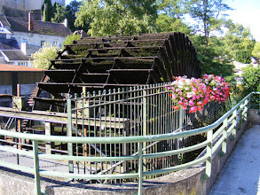 Photo: The Ourcq River passes through town, thus the now decorative water wheel, which has the seemingly mandatory flowers planted on the side.