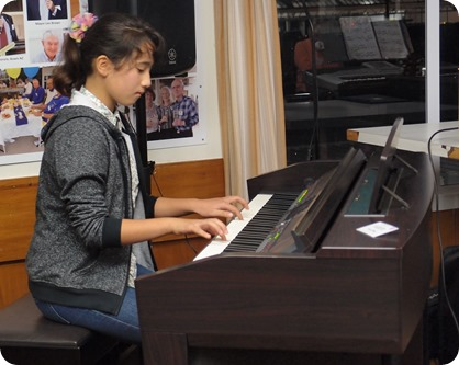 Our little super star, Hana Tani, played the Clavinova magnificently for us. Photo courtesy of Dennis Lyons.