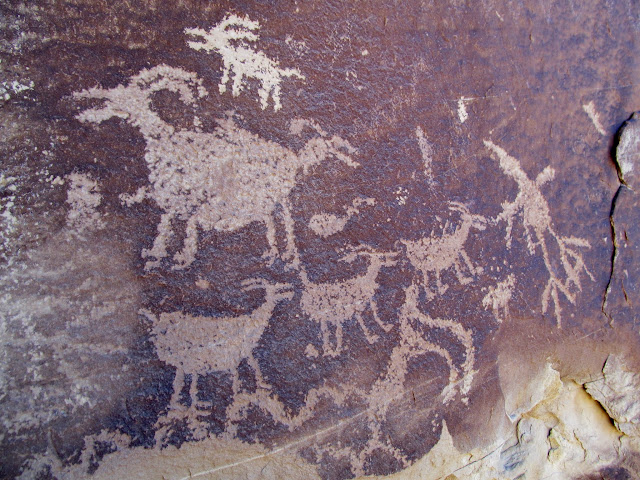 Interesting sheep petroglyphs with mouths open