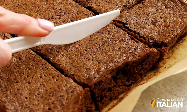 slicing brownies with a plastic knife
