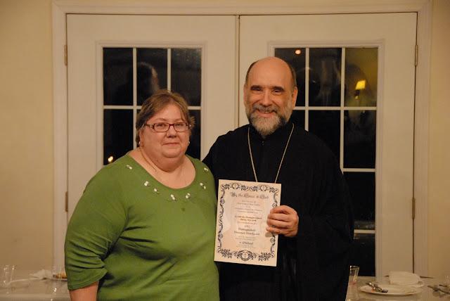 Bp. Michael recognizing the 2012 Distinguished Diocesan Benefactors.