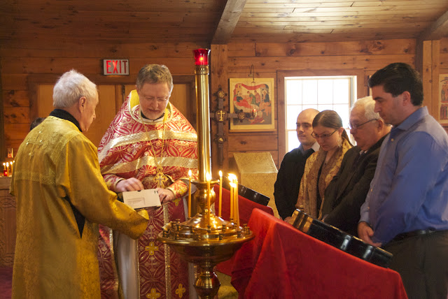 Upon being received into the catechumenate and having prayed the Litany of the Catechumen, the catechumen (joined by existing catechumen Christopher) receive gifts to aid their journey towards Chrismation.