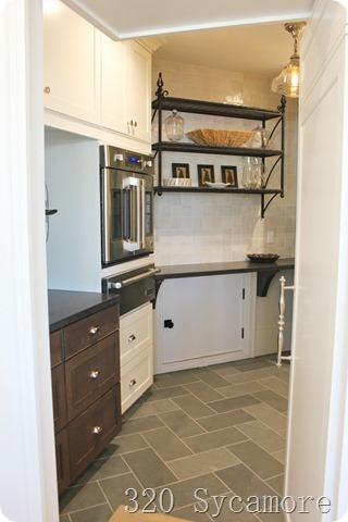 pantry with microwave and door