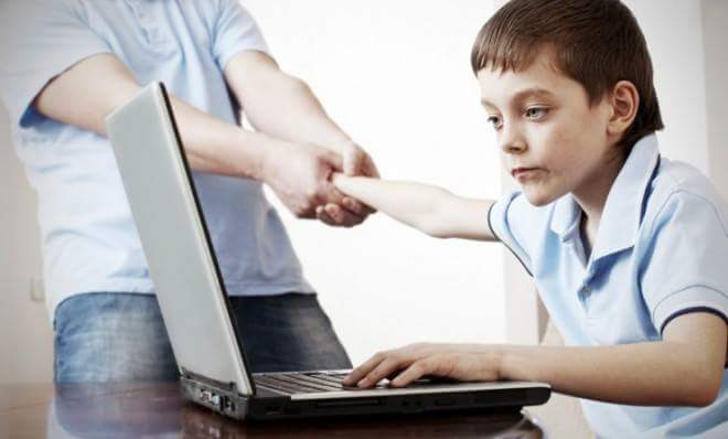 father forcing his son to leave the laptop