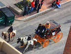 The stock show parade with a wagon...