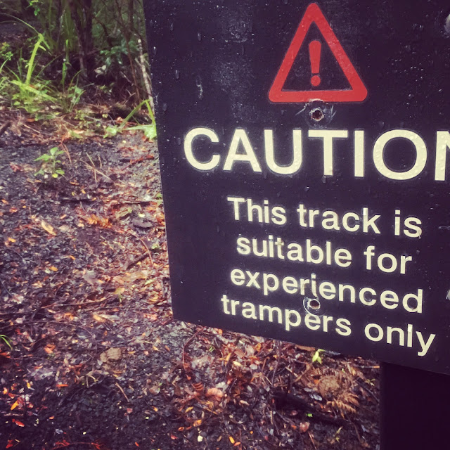 Warning sign Waitakere Ranges: Caution this trail is suitable for experienced trampers only