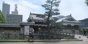 eating strawberries in front of Hiroshima Castle