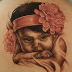 pt00962-baby-portrait-tattoo-kelly-doty-042210.jpg