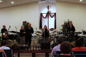 Charles singing wtih his sisters, glorifying God.
