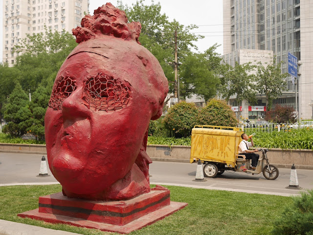 """Red Sculpture"" from ""Three For You"" by Gianni Dessi in front of the Parkview Green in Beijing"