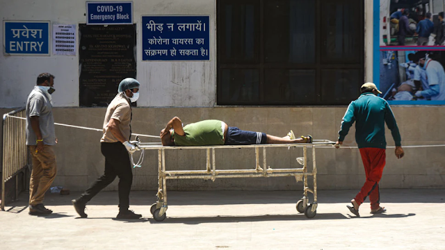 India's Health Care System In 'Total Collapse' As COVID Surge 'Ravages' Country
