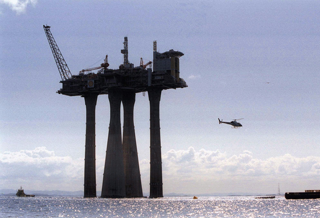 Shell Oil announced in 1989 that it was raising its 'Troll' North Sea natural gas platform a meter or two in anticipation of climbing sea levels caused by climate change. Photo: Morten Hval / Associated Press