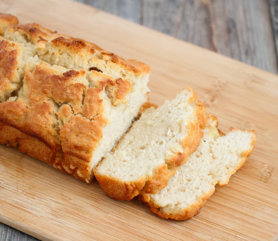 photo of apple cider bread sliced on a cutting board