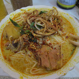 Nom banchok with red curry pork at Central market in Phnom Penh