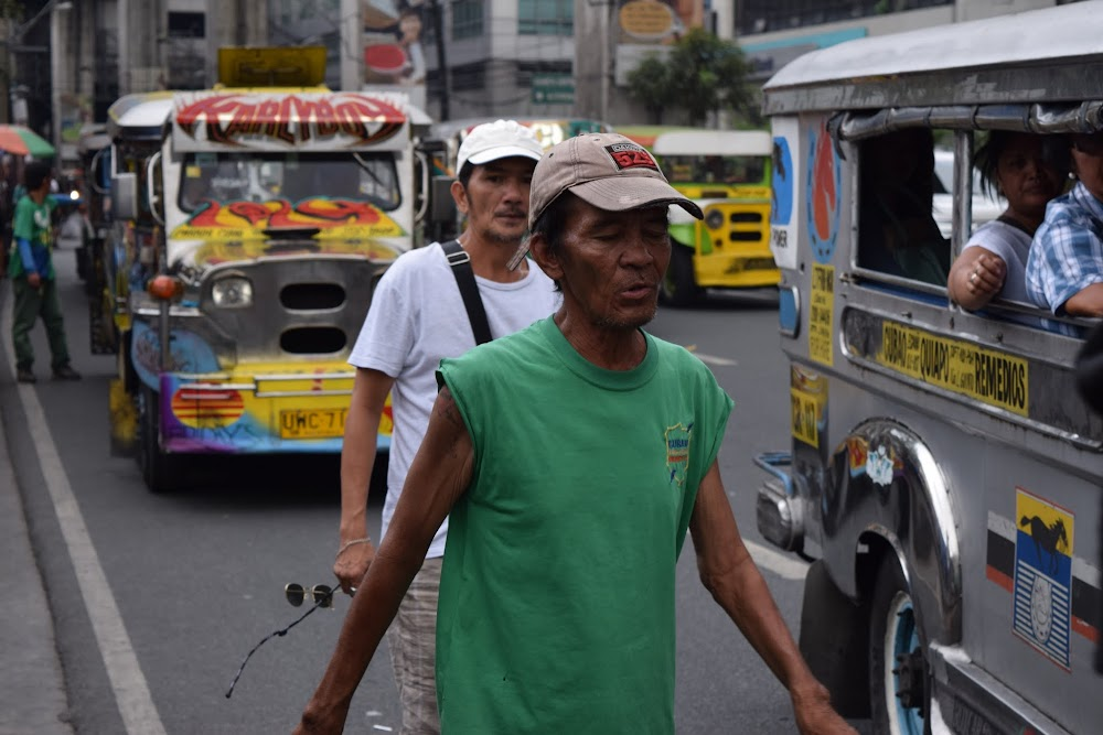 Jeepney workers in action