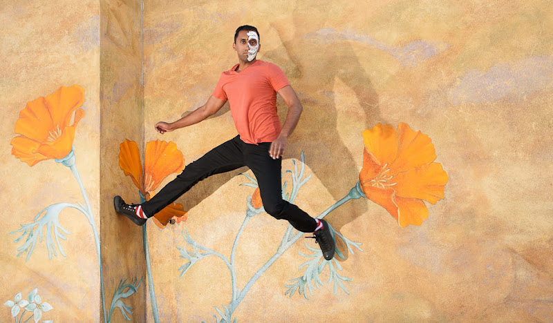 Men's DoD Britches jump against flowered wall