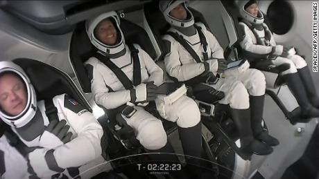 SpaceX launches four people to orbit in company's first-ever tourism mission (photos/videos)