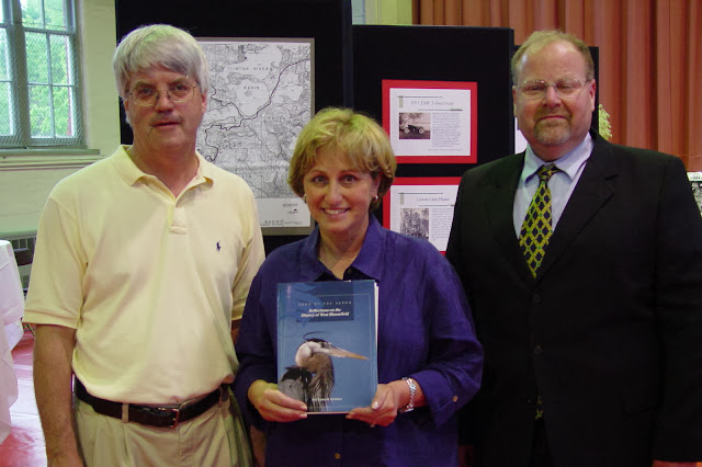 Song of the Heron: Reflections on the History of West Bloomfield 2004 book launch party. L to R: GWBHS President Buzz Brown, West Bloomfield Library Director Clara Bohrer, West Bloomfield Supervisor David Flaisher