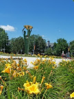 Water Spirits sculpture and lilies