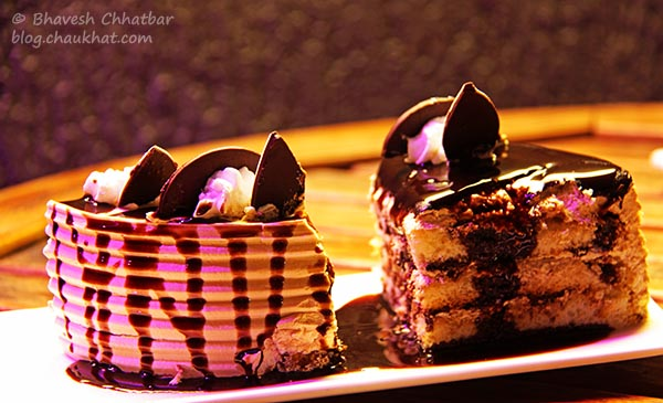 Other Side of the Blueberry Cheese Cake and Chocolate Caramel Cake at The Flying Saucer Sky Bar, Viman Nagar, Pune
