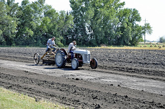 Photo: Locals Tilling the Field