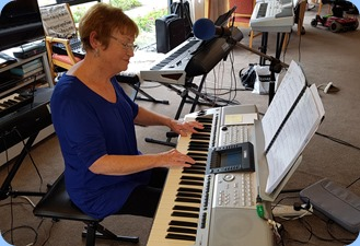 Our Events Manager, Diane Lyons, playing her Yamaha PSR-3000.