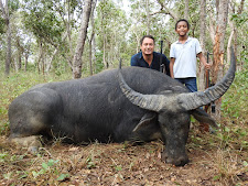 Mr Kooijmann with his son and another nice buffalo bull