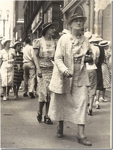 BELL_Florence walking downtown in hat_1938