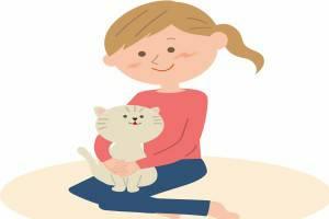 女性の膝の上に乗るネコ