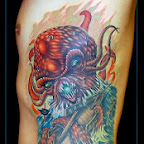 Octopus attack - Rib Side Tattoos Designs