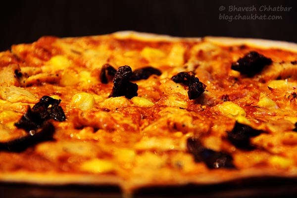 Close-up of Cornish Chicken Thin Crust Pizza at Frisco, Koregaon Park, Pune