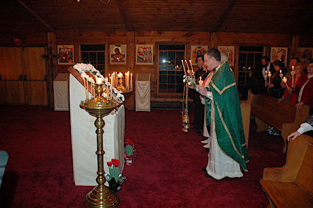Fr. John censes during the Paschal Odes.  With each censing, he wears a different color vestment, illustrating that Pascha is the fulfillment and culmination of all Feasts.