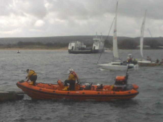 18 September 2011 - 2 crew members go ashore to speak to the swimmer