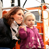Ava with mum Nikki wondering what all the fuss is about. 25 January 2014 Photo: RNLI Poole/Rob Inett