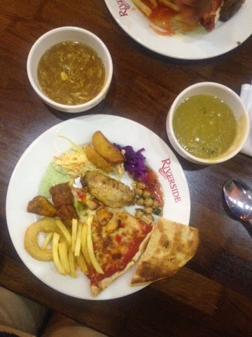 Potato wedges, pizza, fries and chicken soup at Riverside Lounge buffet, London
