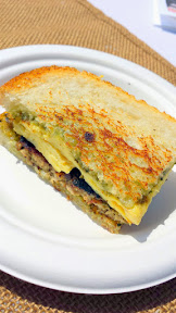 Portland Monthly Country Brunch 2015, Fried Egg I'm in Love brought a breakfast sandwich called Yolko Ono featuring house pork sausage with pesto served on toasted sourdough with an over medium fried egg and a sprinkle of parmesan
