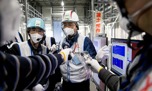 A Tepco employee speaks to the media at the company's Fukushima Daiichi nuclear power plant. Photo: Reuters