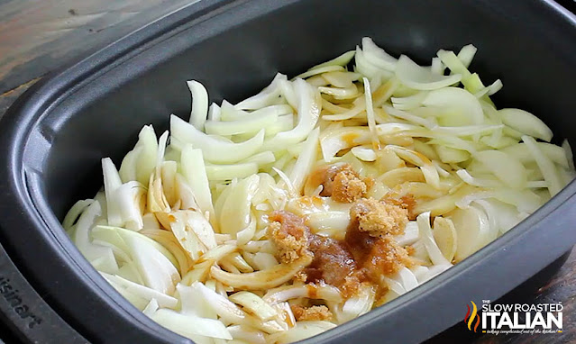 Onions and seasonings in the crock pot