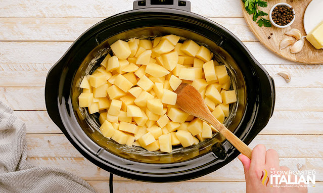 slow cooker mashed potatoes - cut potatoes in crock pot