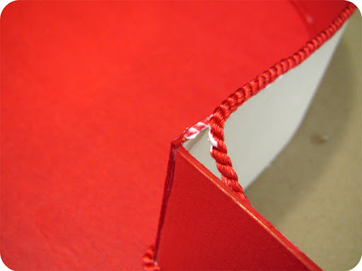 Repeat the same process for gluing red cord to the top edge.