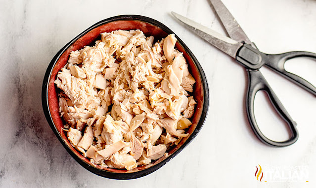 chopped rotisserie chicken in a bowl