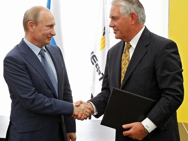 Russian President Vladimir Putin, left, and Exxon Mobil Corp. CEO Rex Tillerson shake hands at a signing ceremony of an agreement between state-controlled Russian oil company Rosneft and Exxon Mobil in Tuapse, Russia, in June 2012. Photo: AP